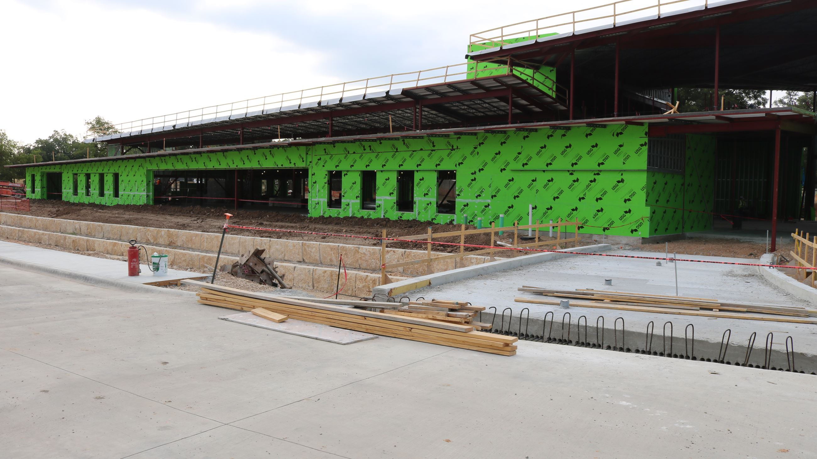 e5f60beda47e The exterior wall of the library is now up and crews are making progress on  key portions of the complex.