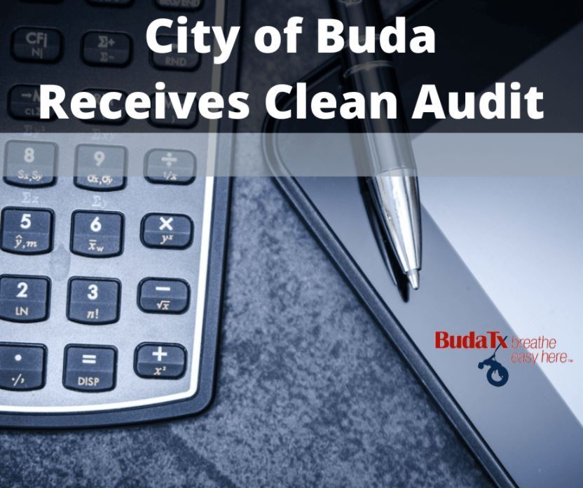 image of calculator and pen text city of buda receives clean audit